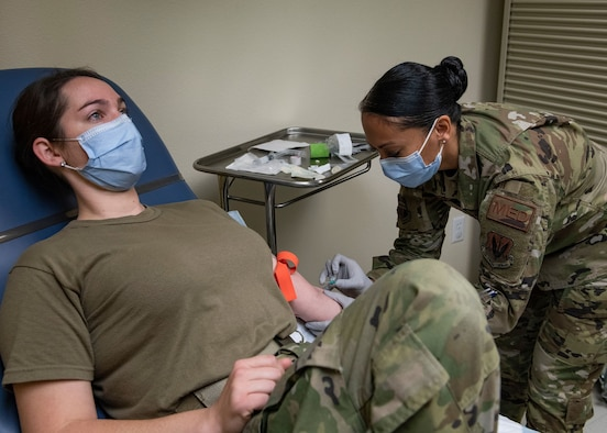 U.S. Air Force Tech. Sgt. Ulla Strömberg, 9th Health Care Operations Squadron Family Care Flight section chief, right, prepares an intravenous access for Staff Sgt. Marissa Smyth, 9th HCOS Family Health Clinic NCOIC, at Beale Air Force Base, California, May 1, 2020. Strömberg was demonstrating the proper procedures for training purposes. (U.S. Air Force photo by Airman Jason W. Cochran)