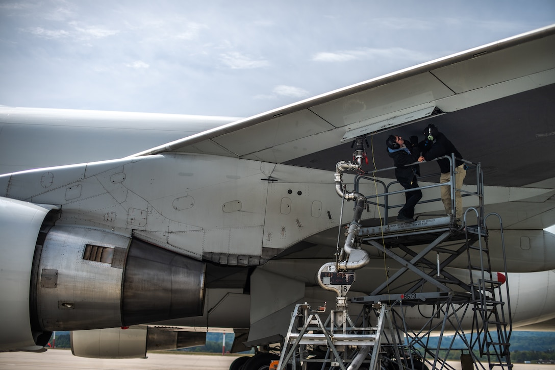 Photo of Airman refueling a jet
