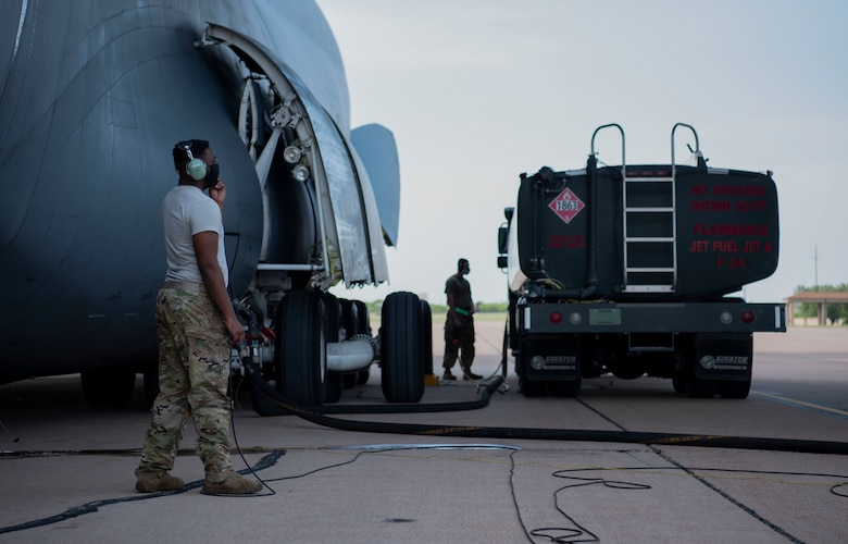 Staff Sgt. James Green, 9th Airlift Squadron, refuels a C-5 Galaxy assigned to Dover Air Force Base, Delaware, at Dyess AFB, Texas, April 27, 2020. The C-5 transported Bomber Task Force equipment for four B-1B Lancers and approximately 200 Airmen to Andersen AFB, Guam. The BTF supports Pacific Air Forces' training efforts with allies, partners and joint forces; and strategic deterrence mission to reinforce the rules-based international order in the Indo-Pacific region (U.S. Air Force photo by Airman 1st Class Nicole Molignano)