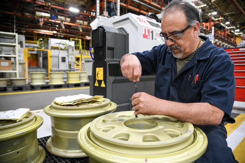 Curtiz Prieto, 309th Commodities Maintenance Group machinist, works on an F-35 wheel.