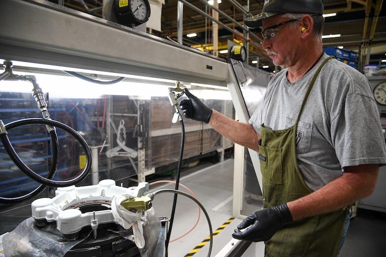 Bill Zampedri, 309th Commodities Maintenance Group E&I inspector, tests C-130 brake components.