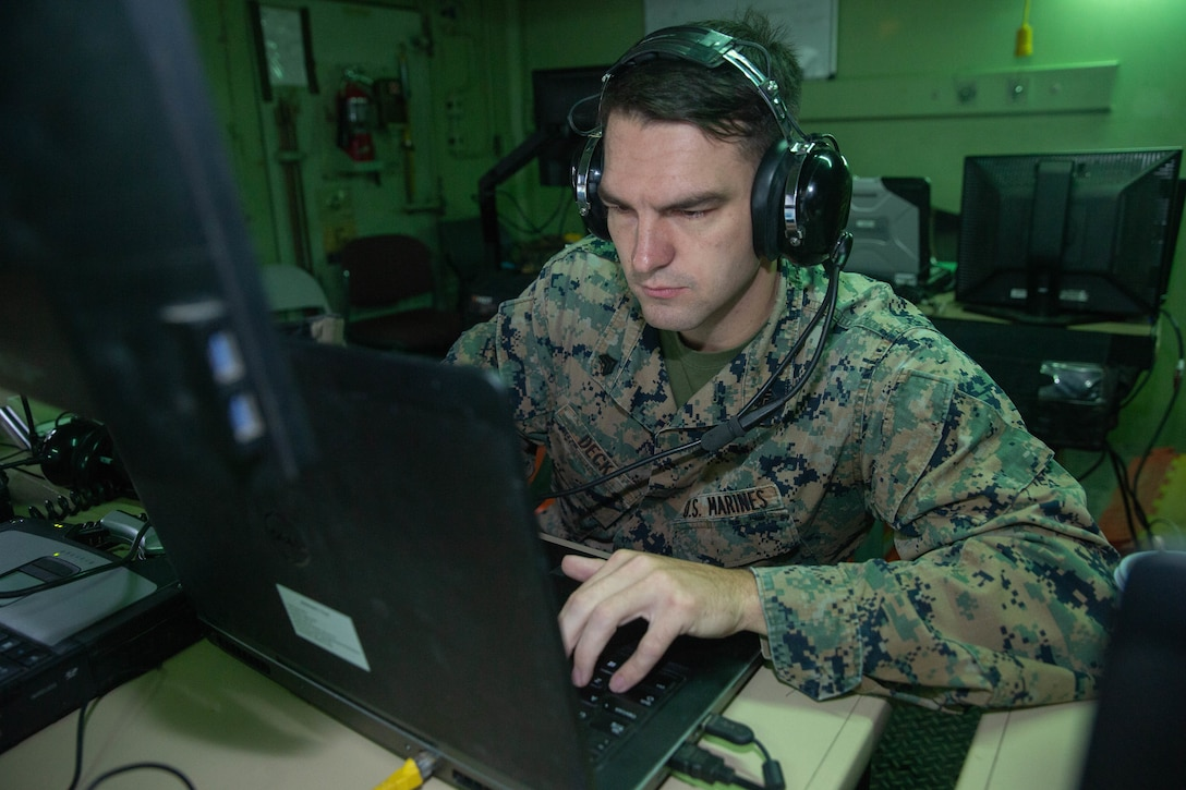 A U.S. Marine inputs data into a computer during a flight simulation at Marine Corps Air Station Cherry Point, N.C., Nov. 15.