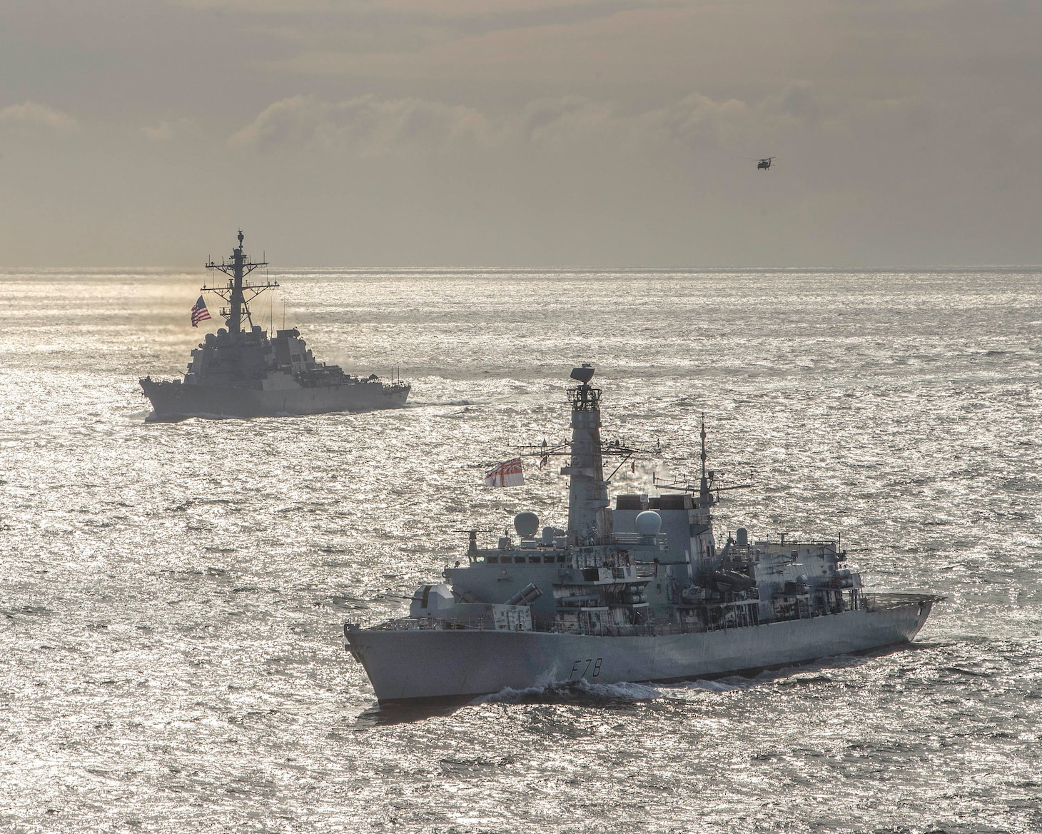 ARCTIC OCEAN (May 5, 2020) The Type-23 Duke-class frigate HMS Kent (F78), the Arleigh Burke-class guided-missile destroyer USS Roosevelt (DDG 80), the Arleigh Burke-class guided-missile destroyer USS Porter (DDG 78), the Arleigh Burke-class guided-missile destroyer USS Donald Cook (DDG 75), and USNS Supply (T-AOE-6) conduct a photo exercise (PHOTOEX) while conducting joint operations to ensure maritime security in the Arctic Ocean, May 5, 2020.