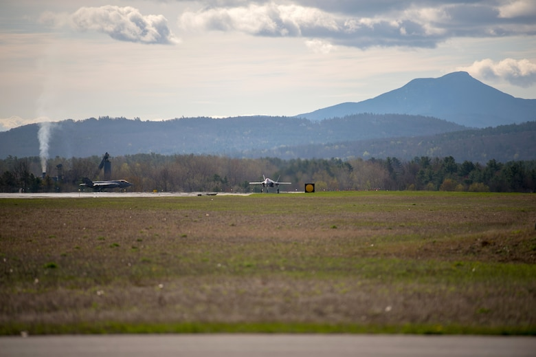Two F-35 Lightning IIs approach the runway at the Vermont Air National Guard Base.