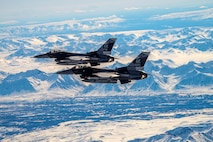 Two F-16 Fighting Falcons assigned to the 18th Aggressor Squadron fly over Denali National Park May 5, 2020.