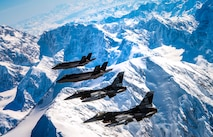 Two F-35A Lightning IIs assigned to the 356th Fighter Squadron and two F-16 Fighting Falcons assigned to the 18th Aggressor Squadron fly over Denali National Park in Alaska May 5, 2020.