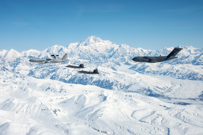 An E-3 Sentry, two F-22 Raptors and a C-17 Globetrotter assigned to Joint Base Elmendorf-Richardson fly over Alaska May 5, 2020.