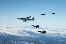 An E-3 Sentry, two F-22 Raptors and two F-35A Lightning IIs fly over Alaska May 5, 2020.