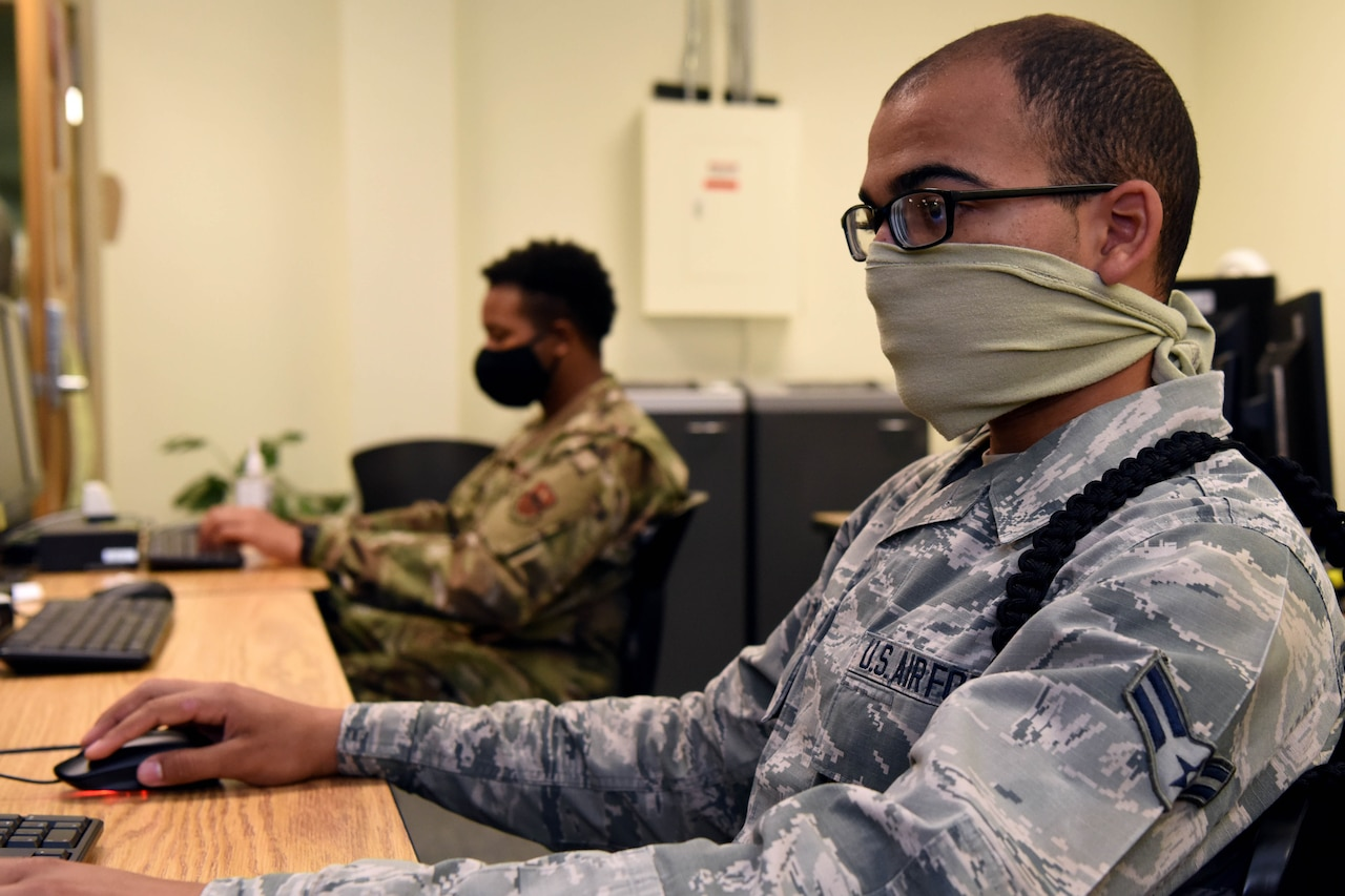 An airman working at a computer.