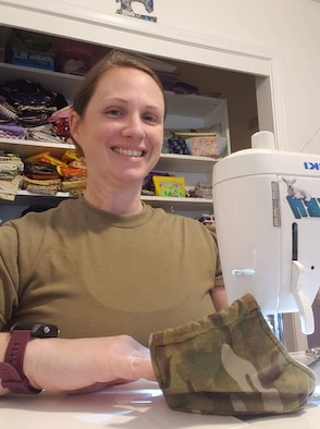 From her sewing machine at home, Staff Sgt. Rachel Yandon works on the 150 masks she donated for a Regional Medical Center in Alabama, May 7, 2020.  She then moved on to provide masks to coworkers at the Western Air Defense Sector.