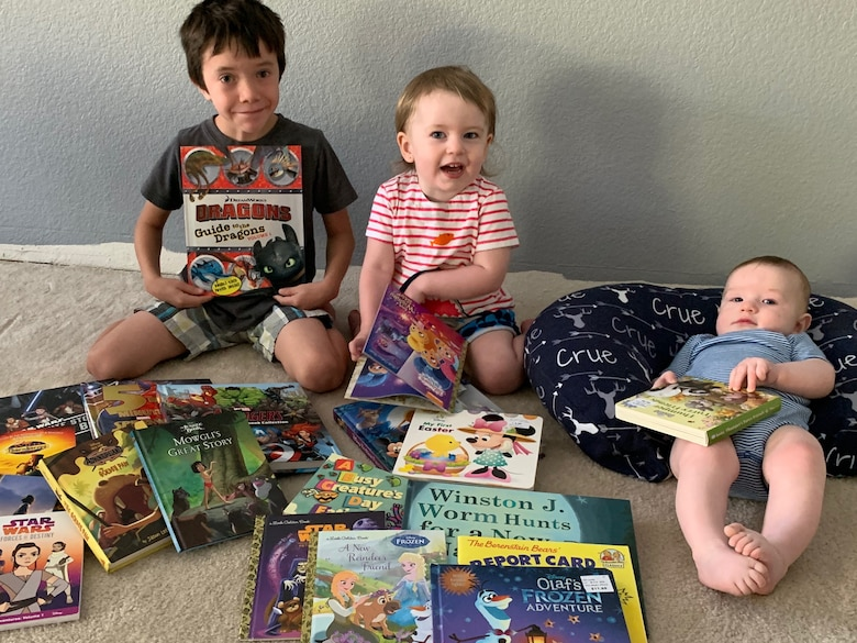 Jaxon, Cali and Crue Moore pose with their books from the, Be a Book Hero campaign, May 6, 2020, Beale Air Force Base, California. The campaign assisted in providing 700 books to children within the AMMO community (Courtesy photo, Master Sgt. Aaron S. Moore, 9th Civil Engineering Squadron, unaccompanied housing superintendent