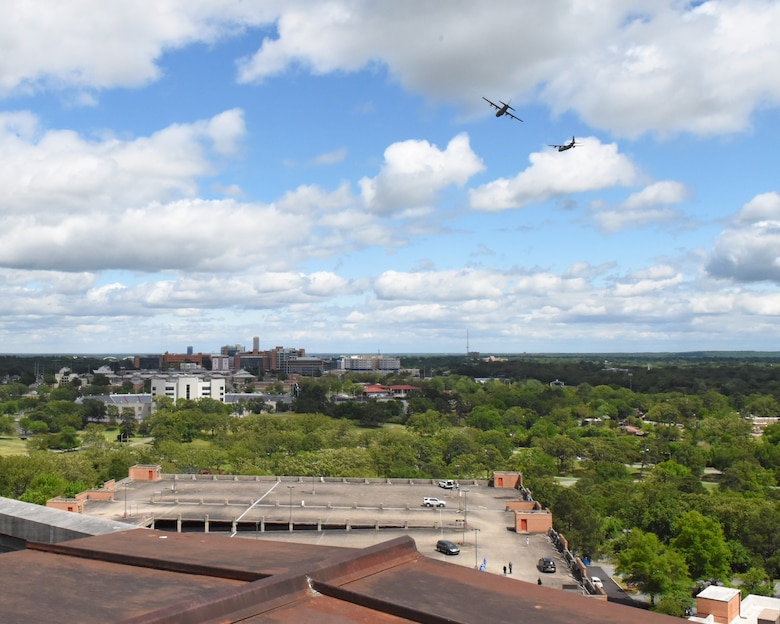 Two C-130s fly over the city