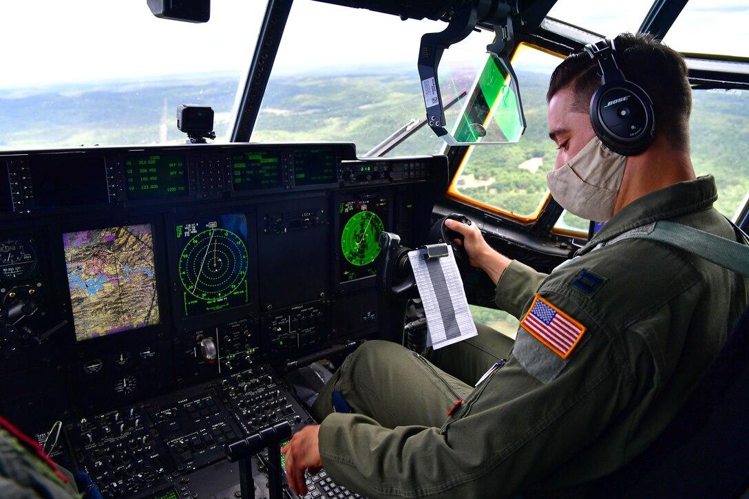 C-130s fly over the city of Little Rock Arkansas
