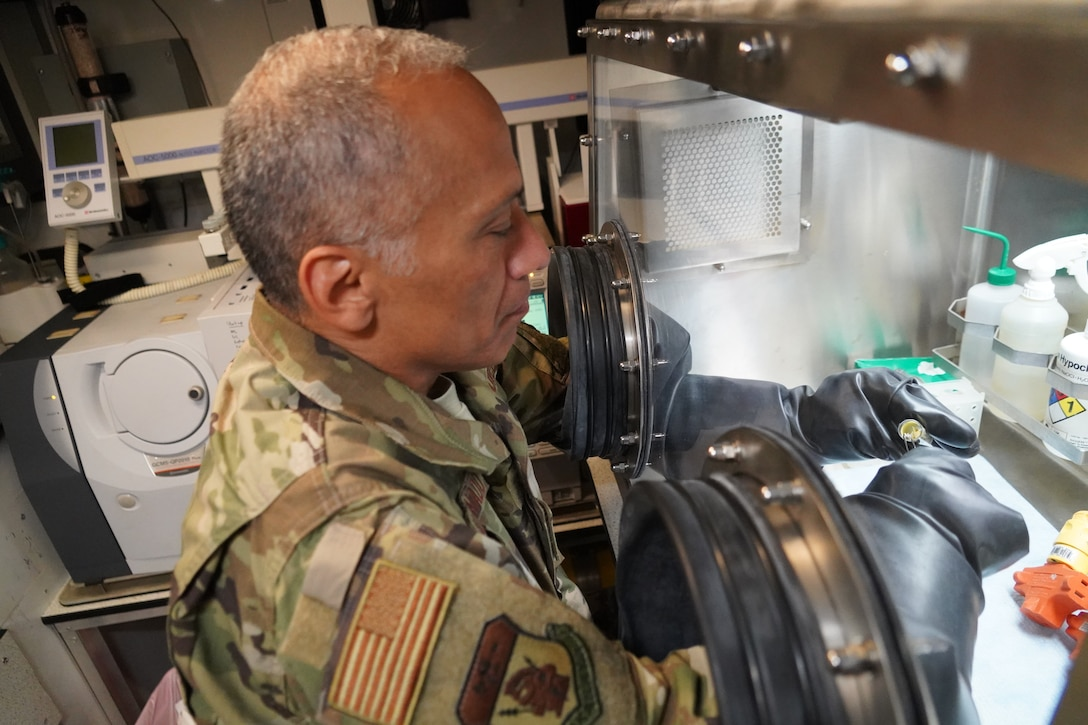 U.S. Air Force Master Sgt. Emelio Maldonado, 93rd Civil Support Team healthcare non-commissioned officer in charge, processes a sample in a glove box at Naval Air Station Barber's Point, Hawaii, Feb. 28th, 2020. The 93rd Civil Support Team is conducting refresher training on respirators and personal protective equipment for Hawaii National Guardsmen in response to the COVID-19 pandemic.