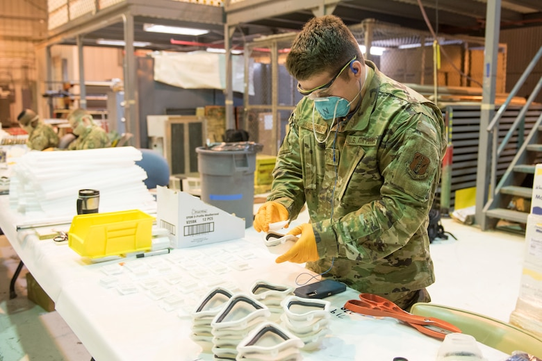 Staff Sgt. Anthony Vanorsdale, places a filter piece into an N95 face mask at the 167th Airlift Wing, April 30, 2020. West Virginia National Guardsmen assigned to Task Force Innovation have produced more than 1500 of the cast mold masks developed by staff at Shepherd University.
