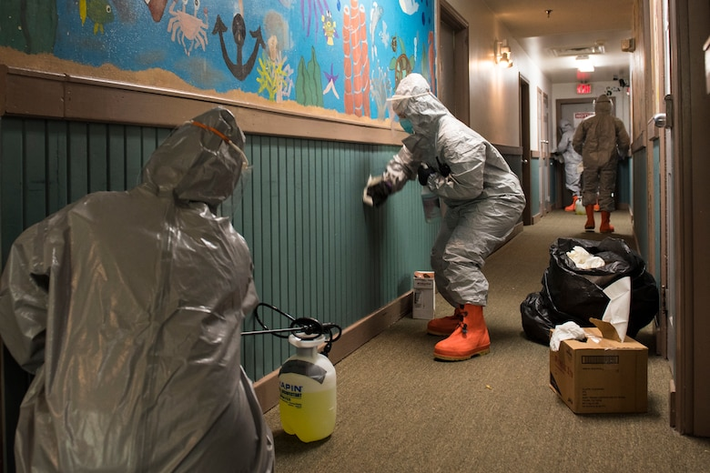West Virginia National Guard Soldiers and Airmen assigned to Task Force Chemical, Biological, Radiological and Nuclear (CBRN) Response Enterprise (CRE) East, sanitize the Children's Home Society in Romney, Va., May 1, 2020. Task Force CRE has conducted sanitization and decontamination, COVID-19 swabbing, and personal protective equipment training across the state as part of the COVID-19 response efforts.