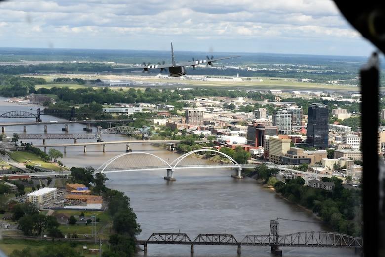 A C-130 flies of the Arkansas River