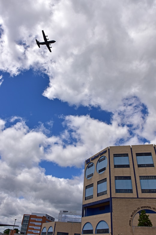 U.S. Air Force C-130s from Little Rock Air Force Base fly over Veterans Affairs Medical Center in downtown Little Rock Arkansas, May 8, 2020. The flyover was part of America Strong; a collaborative salute to recognize healthcare workers, first responders, military, and other essential personnel while standing in solidarity with all Americans during the COVID-19 pandemic. (U.S. Air Force photo by Staff Sgt. Jeremy McGuffin)