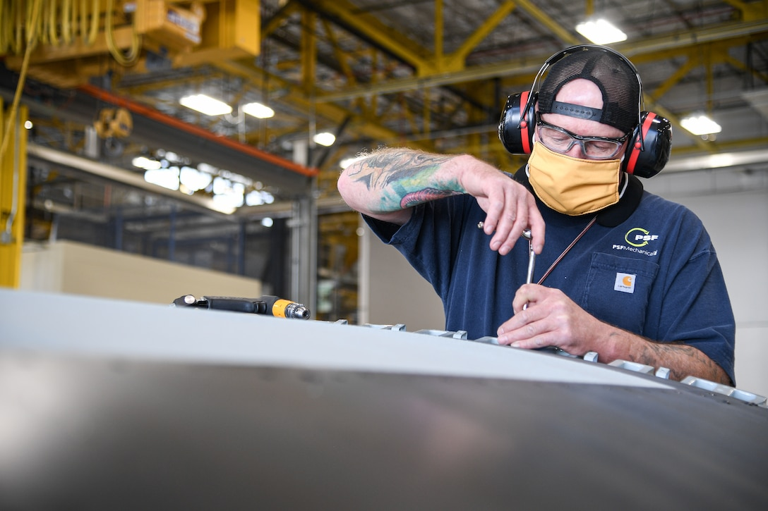 Troy Pattillo, 309th Commodities Maintenance Group sheet metal mechanic, works on an A-10 outer wing.