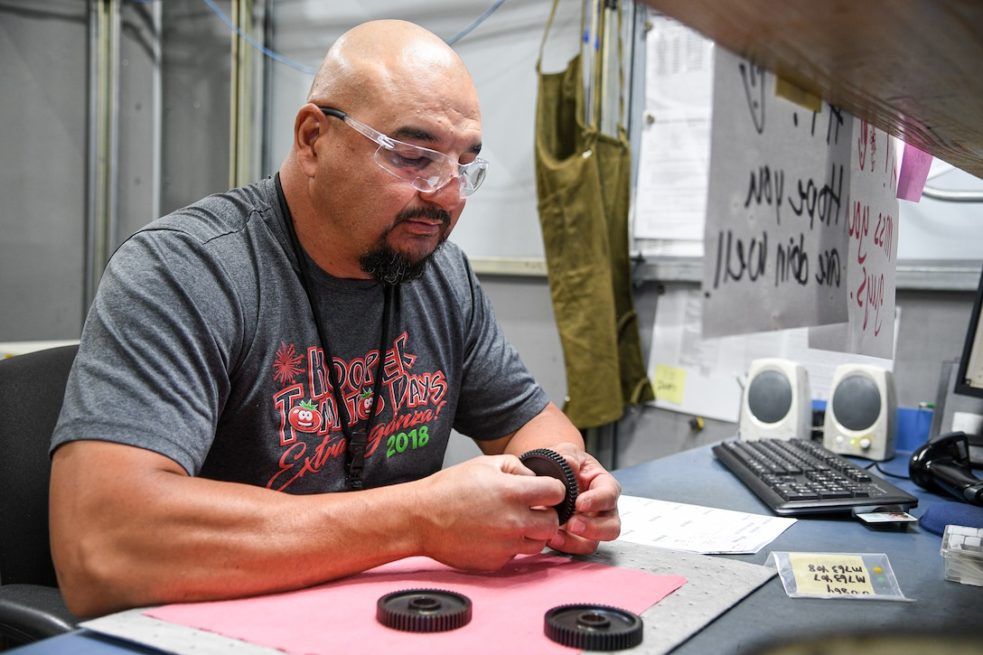Jamie Garcia, 309th Commodities Maintenance Group, inspects A-10 starter components.
