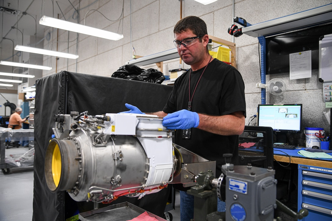 Chris Gardner, 309th Commodities Maintenance Group, works on an F-16 fuel system assembly.