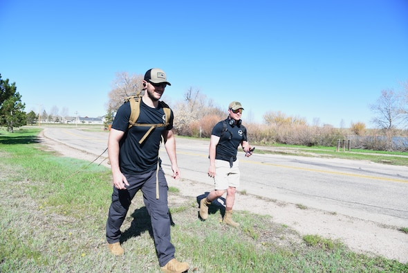 Sergeant Rosenquist and Airman Cole start their ruck march