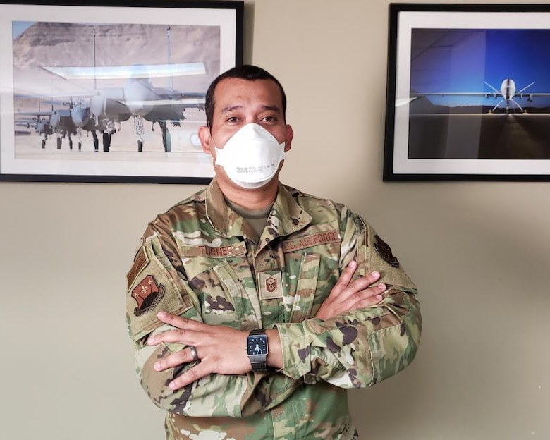 Master Sgt. Alexander Turner, 706th Fighter Squadron first sergeant, Nellis Air Force Base, Nevada, May 2, 2020. Turner has been working non-stop to ensure his Airmen are taken care of with food security, financial readiness and resiliency during the COVID-19 pandemic.