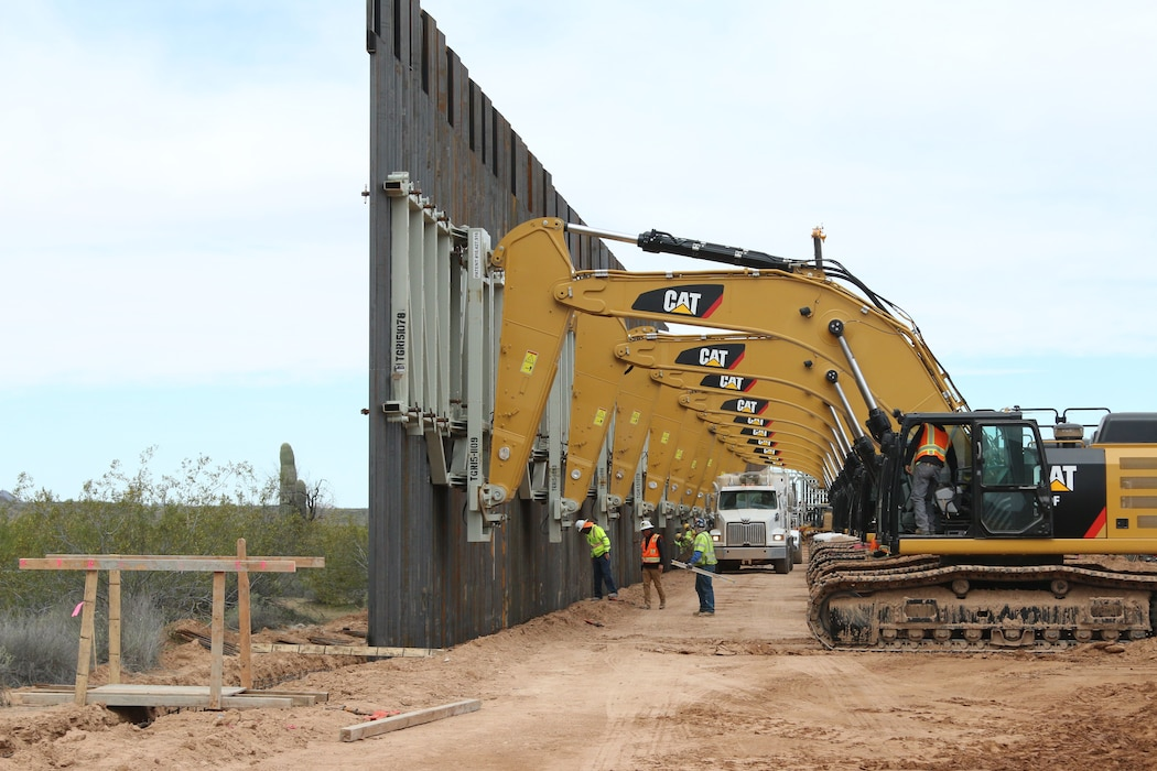 A U.S. Army Corps of Engineers South Pacific Border District contractor crew inspects the trench where 30-foot barrier panels were recently placed near the U.S.-Mexico border at Yuma, Arizona, March 26.