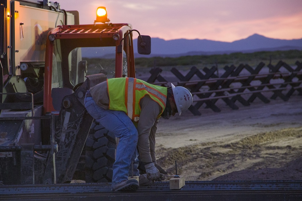 U.S. Army Corps of Engineers South Pacific Border District contractor crews install border barrier throughout the night near Columbus, New Mexico, April 17.