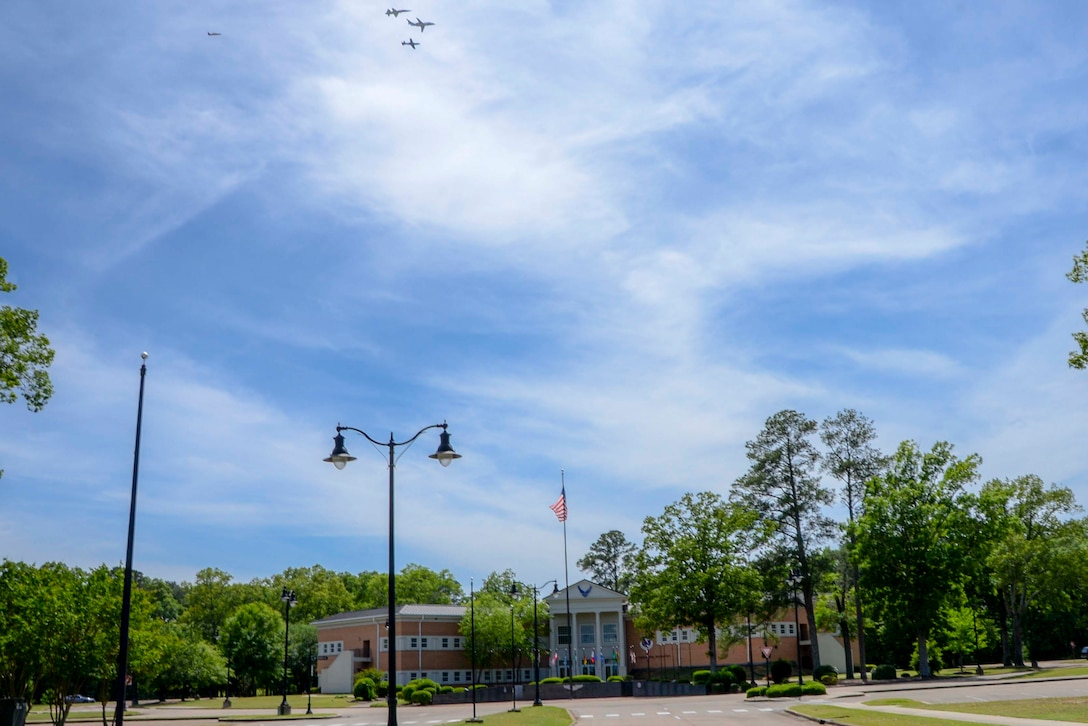 A dissimilar formation of aircraft from Columbus Air Force Base, Miss., fly over Columbus AFB May 9, 2020. The flyover was an opportunity to honor the men and women on the front lines in the fight against COVID-19 during the Defense Department's #AmericaStrong salute. The flyover consisted of the T-6A Texan II, T-1A Jayhawk and the T-38 Talon. (U.S. Air Force photo by Tech. Sgt. Christopher Gross)