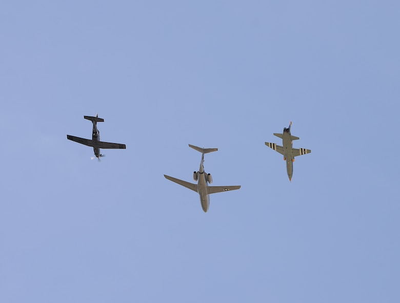 A dissimilar formation of aircraft from Columbus Air Force Base, Miss., fly over The Koritz Clinic. on May 9, 2020. The flyover was an opportunity to honor the men and women on the front lines in the fight against COVID-19 during the Defense Department's #AmericaStrong salute. The flyover consisted of the T-6A Texan II, T-1A Jayhawk and the T-38 Talon. (U.S. Air Force photo by Airman 1st Class Hannah Bean)