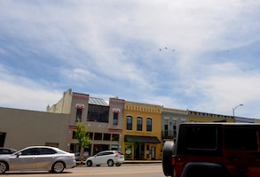 A dissimilar formation of aircraft from Columbus Air Force Base, Miss., fly over Main Street in Columbus, Miss. on May 9, 2020. The flyover was an opportunity to honor the men and women on the front lines in the fight against COVID-19 during the Defense Department's #AmericaStrong salute. The flyover consisted of the T-6A Texan II, T-1A Jayhawk and the T-38 Talon. (U.S. Air Force photo by Airman 1st Class Davis Donaldson)