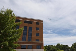 A dissimilar formation of aircraft from Columbus Air Force Base, Miss., fly over Baptist Memorial Hospital in Columbus, Miss. May 9, 2020. The flyover was an opportunity to honor the men and women on the front lines in the fight against COVID-19 during the Defense Department's #AmericaStrong salute. The flyover consisted of the T-6A Texan II, T-1A Jayhawk and the T-38 Talon. (U.S. Air Force photo by Airman 1st Class Jake Jacobsen)