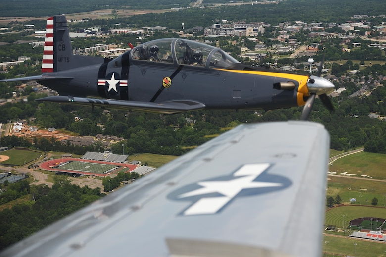A T-6 Texan II flies in a dissimilar formation of aircraft from Columbus Air Force Base, Miss., over Starkville, Miss., May 9, 2020. The flyover was an opportunity to honor the men and women on the front lines in the fight against COVID-19 during the Defense Department's  #AmericaStrong salute. The flyover consisted of the T-6A Texan II, T-1A Jayhawk and the T-38 Talon. (U.S. Air Force photo by Senior Airman Keith Holcomb)