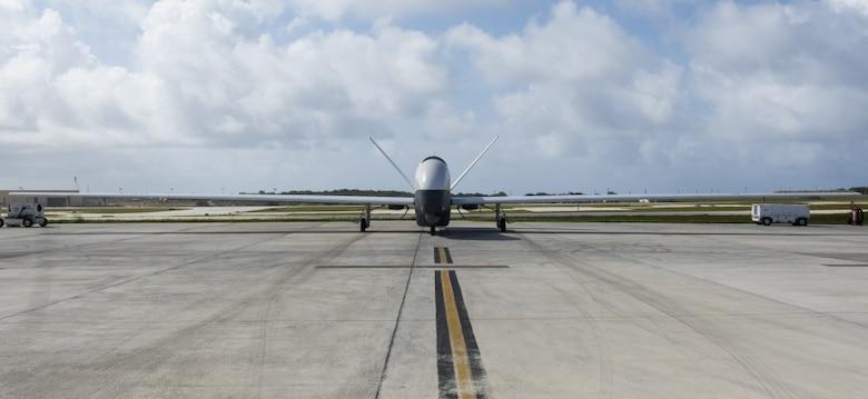 A MQ-4C Triton taxis at Andersen Air Force Base