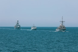 200428-A-DZ781-0002 ARABIAN GULF (May 28, 2020) – The HMS Argyll, HMS Shoreham and the mine countermeasures ship USS Dextrous (MCM 13) participate in the bilateral Mine Countermeasures Exercise 2020 (MCMEX 20) with the mine countermeasures ship USS Gladiator (MCM 11) in the Arabian Gulf, March 28. Gladiator is forward-deployed to the U.S. 5th Fleet area of operations in support of naval operations to ensure maritime stability and security in the Central region, connecting the Mediterranean and the Pacific through the Western Indian Ocean and three strategic choke points. (U.S. Army photo by Pfc. Christopher Cameron)