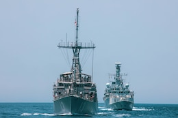 200428-A-DZ781-0017 ARABIAN GULF (May 28, 2020) – The HMS Argyll, HMS Shoreham and the mine countermeasures ship USS Dextrous (MCM 13) participate in the bilateral Mine Countermeasures Exercise 2020 (MCMEX 20) with the mine countermeasures ship USS Gladiator (MCM 11) in the Arabian Gulf, March 28. Gladiator is forward-deployed to the U.S. 5th Fleet area of operations in support of naval operations to ensure maritime stability and security in the Central region, connecting the Mediterranean and the Pacific through the Western Indian Ocean and three strategic choke points. (U.S. Army photo by Pfc. Christopher Cameron)