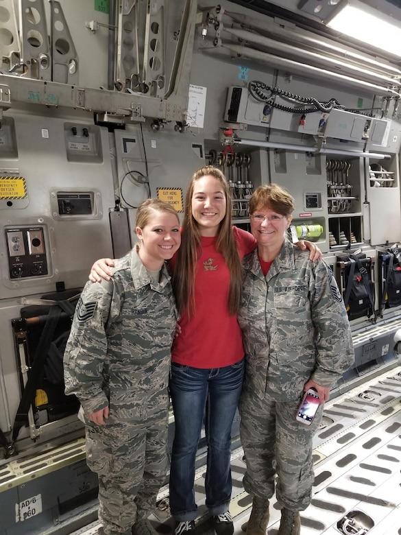 Three women pose for photo