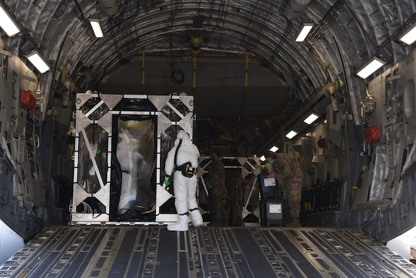 U.S. Air Force Airmen assigned to the 521st Air Mobility Operations Wing decontaminate a Transport Isolation System on a U.S. Air Force C-17 Globemaster III aircraft.