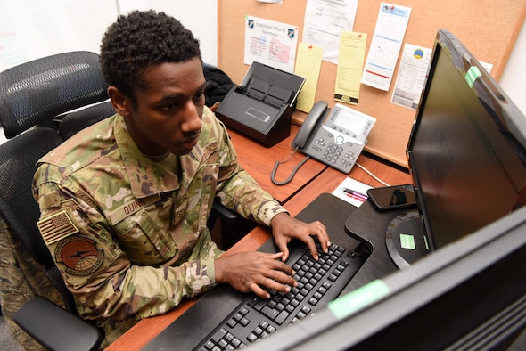 Photo of Airman working on his computer