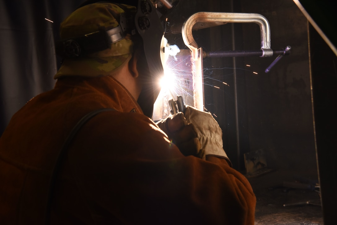 U.S. Air Force Staff Sgt. Israel Gutierrez, 786th Civil Engineer Squadron lock shop noncommissioned officer in charge, fuses metal during a welding course.