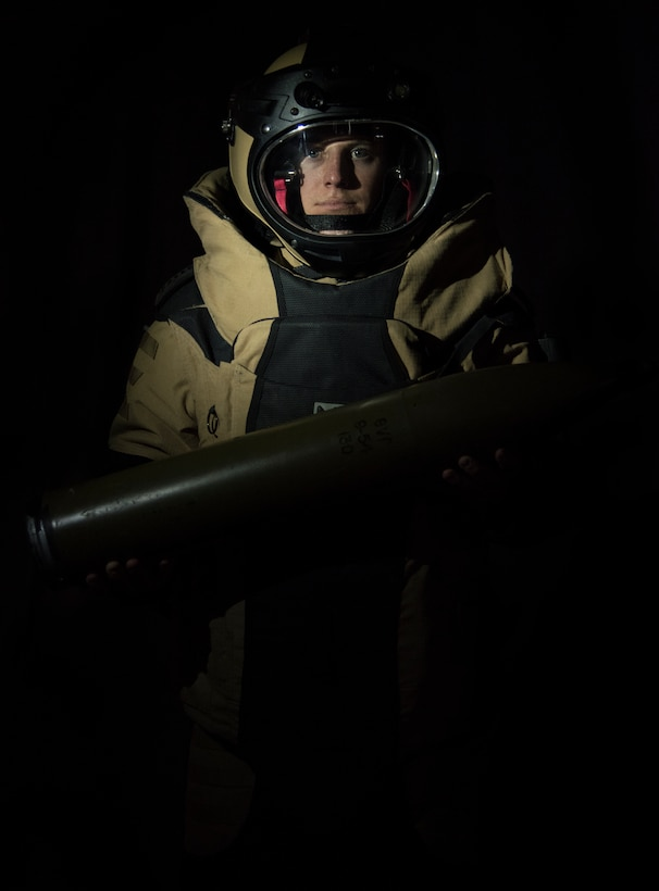 U.S. Air Force Staff Sgt. Michael Long, 786th Civil Engineer Squadron noncommissioned officer in charge of explosive ordnance disposal operations, wears a Med-Eng EOD 9 Bomb Suit while holding a simulated unexploded ordnance at Ramstein Air Base, Germany, May 6, 2020.