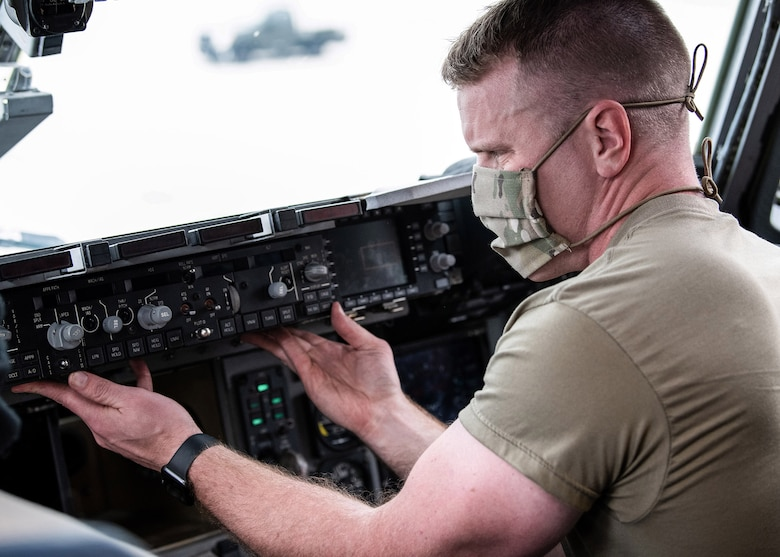 Staff Sgt. Matthew Miklasevich, 445th Aircraft Maintenance Squadron, changes out an auto flight control panel of a C-17 Globemaster III here April 13, 2020. 445th Airlift Wing Reservists continue to fly and maintain its fleet of C-17 aircraft, proving they are ready and staying ready despite the COVID-19 crisis. (U.S. Air Force photo/Mr. Patrick O'Reilly)