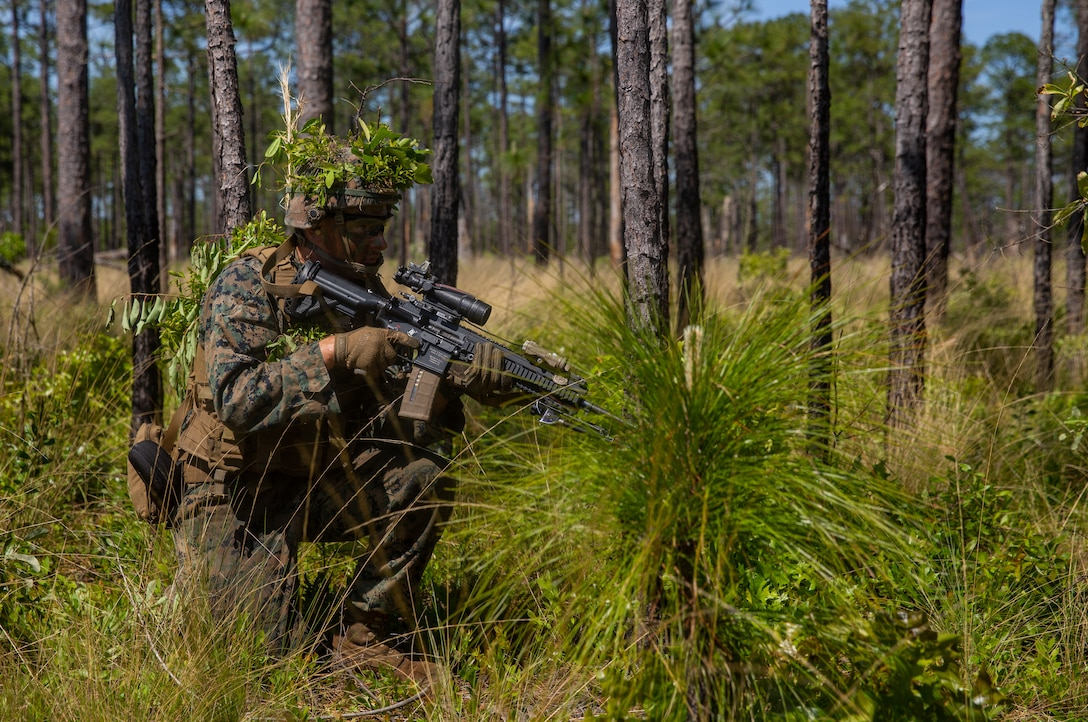 U.S. Marine provides security during a support by fire at Camp Lejeune, North Carolina, May 5.