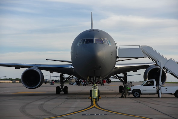 A KC-46A Pegasus sits on the flightline April 30, 2020, at McConnell Air Force Base, Kansas. In April, Boeing and the Air Force reached an agreement to bring a new Remote Vision System to the KC-46, the RVS 2.0. After testing the aircraft's cameras during a three-week test cycle at the Air Force Research Laboratory, Team McConnell and the 344th Air Refueling Squadron played a vital role in the finalization of critical factors in the new camera system. (U.S. Air Force photo by Airman 1st Class Marc Garcia)