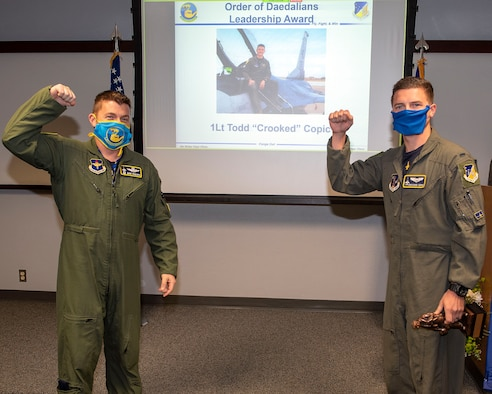 Lt. Col. Jeffrey Shulman, 311th Fighter Squadron commander, presents the Daedalian award to 1st Lt. Todd Copic, 311th FS Basic Course graduate, during the graduation of B-course Class 19-DBH, May 8, 2020, on Holloman Air Force Base, N.M. Twelve B-course students graduated and will be reassigned to operational flying units throughout the Combat Air Force. (U.S. Air Force photo by Staff Sgt. Christine Groening)