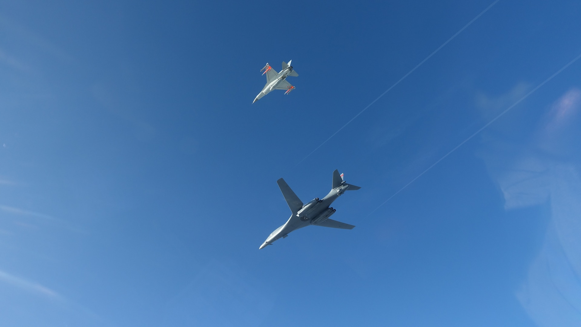 Military aircraft flying in the sky