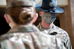 OTS Military Instructor performs open ranks during COVID-19 Pandemic.