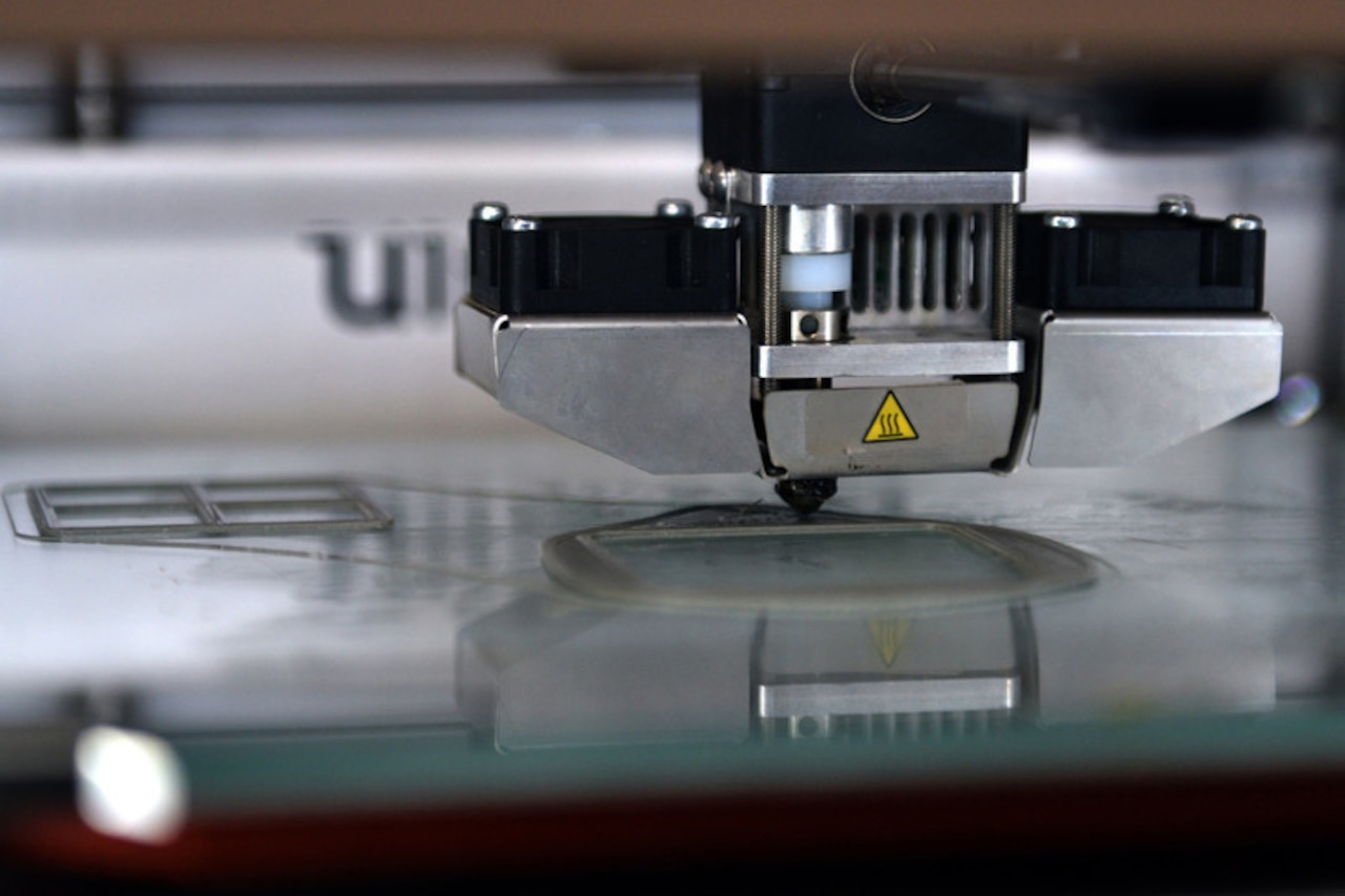 A 3D printer produces  a computer-aided design.