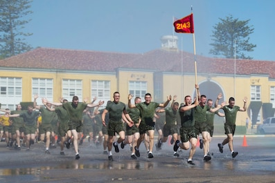 New Marines with Golf Company, 2nd Recruit Training Battalion, participate in a motivational run at Marine Corps Recruit Depot, San Diego, May 7, 2020.